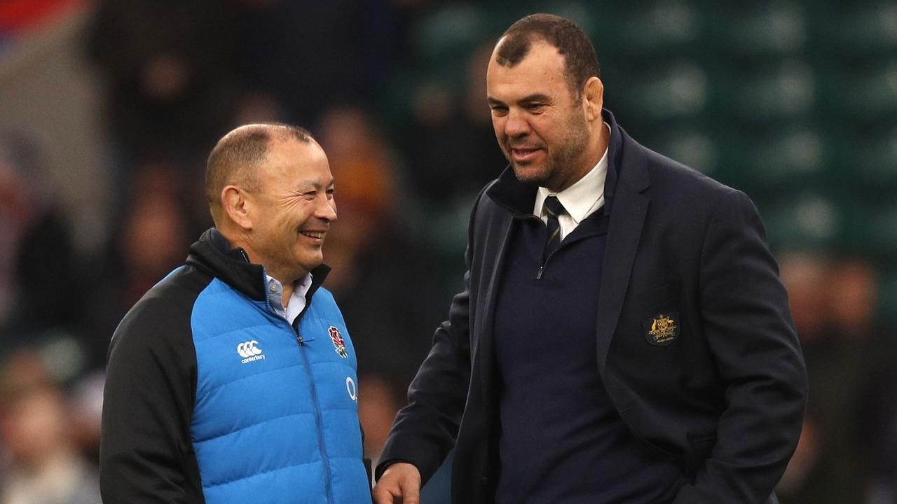 England coach Eddie Jones talks to Australia coach Michael Cheika at Twickenham.