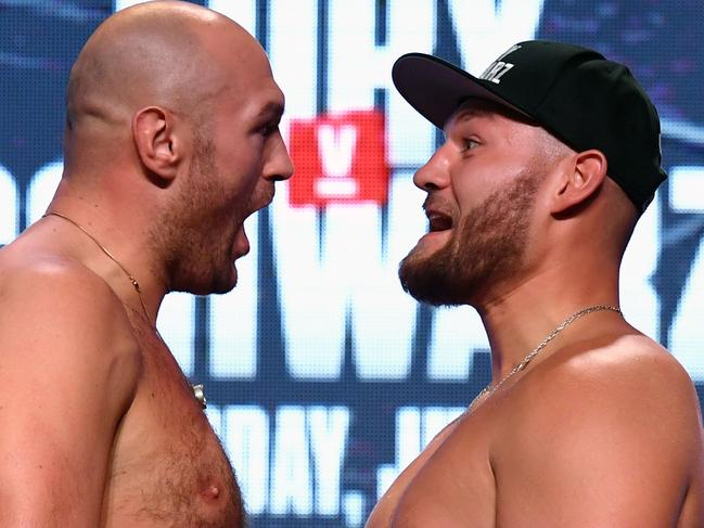 Tyson Fury and Tom Schwarz get animated for the weigh-in.
