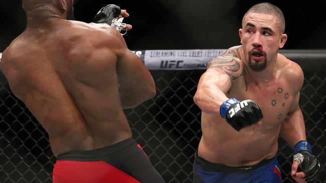 Robert Whittaker throws a punch at Yoel Romero when the pair met in Las Vegas in 2017.