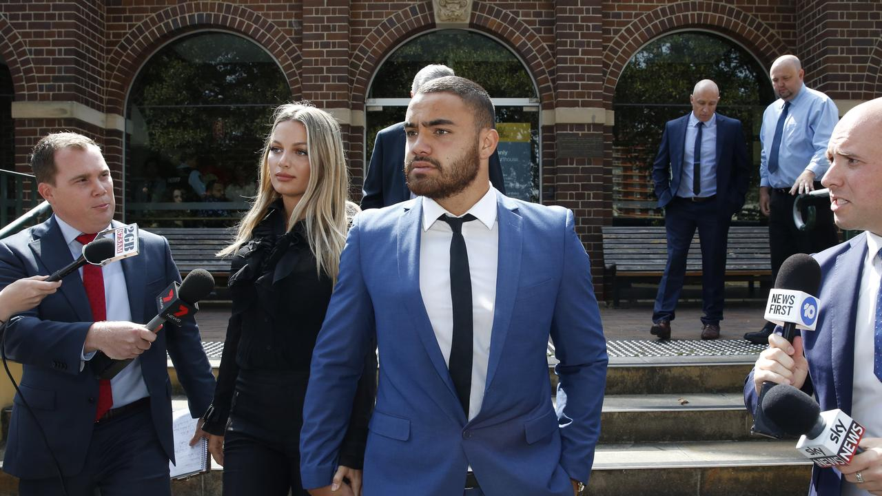 Dylan Walker leaves Manly Local Court with his fiancee, Alexandra Ivkovic.