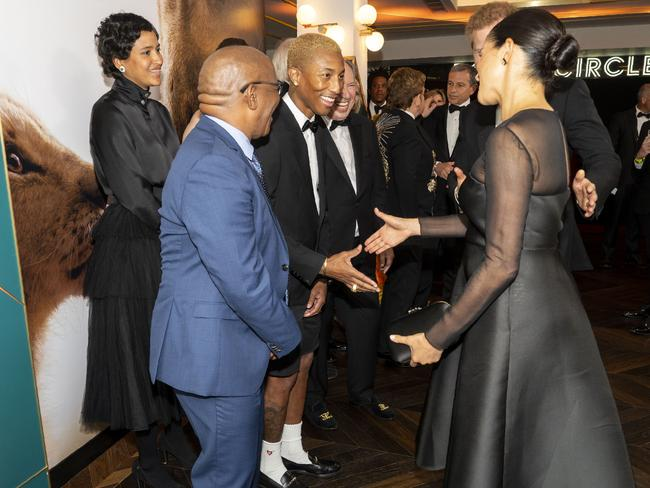 Meghan told US singer Pharrell Williams that royal life is tough. Picture: AFP