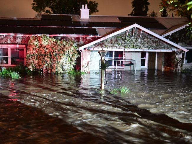 A flooded house in Toorak Gardens, an inner eastern suburb of Adelaide. The colour was reflections from emergency services vehicle. Picture: Campbell Brodie