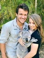 "Looking like a couple with their newborn child... ""Feels good to be back @AustraliaZoo! I think @BindiSueIrwin and I just started hugging all of the koalas the minute arrived."" Picture: Chandler Powell / Instagram"