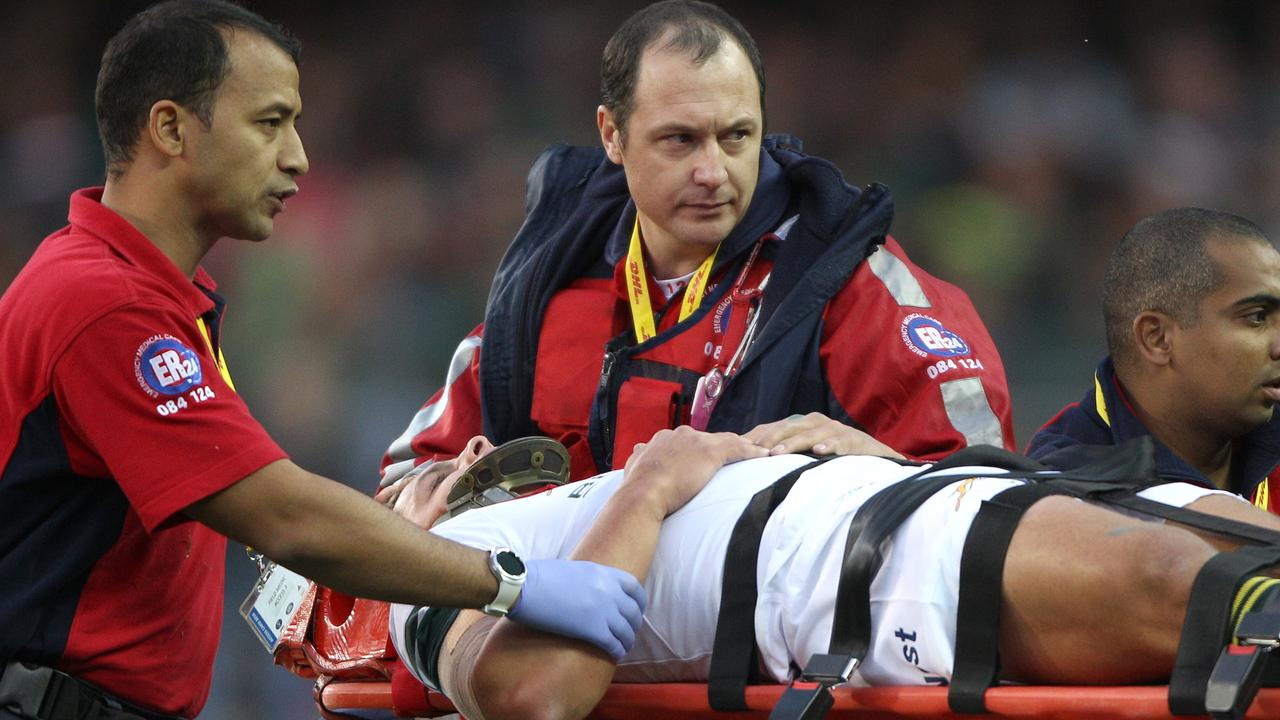 Pat Lambie of South Africa is taken off Newlands on a stretcher in 2016.