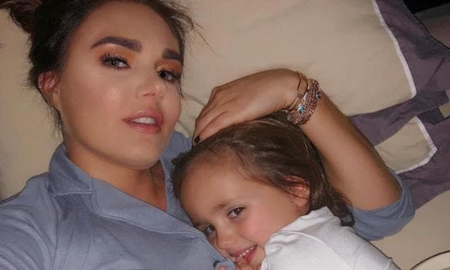 Sophia and her mum in bed. Source: The Sun