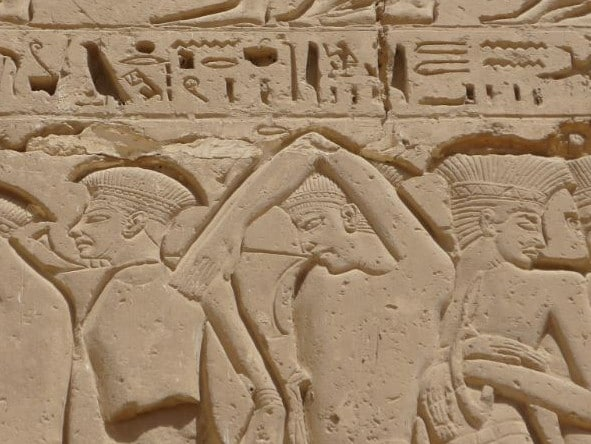 An Egyptian wall relief from the era of Ramses III showing captured Sea People refugees after the Battle of the Delta. Source: Wikimedia