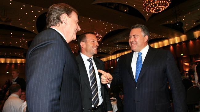 Joke's on you ... Peter Costello, left, with Tony Abbott and Joe Hockey at a past Liberal Party dinner.