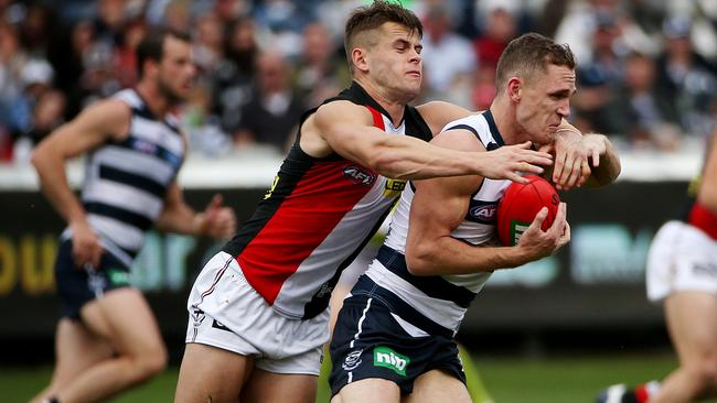 Saint Maverick Weller gets Selwood high in a tackle. Picture: Colleen Petch
