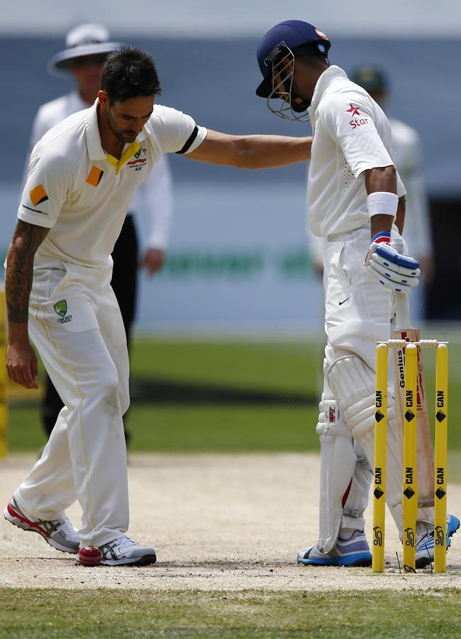 Mitchell Johnson apologises to Virat Kohli. Picture: Wayne Ludbey