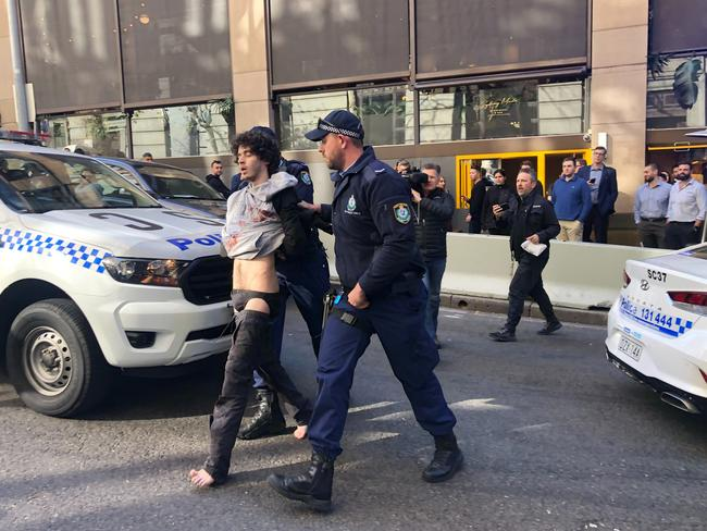 Mert Ney being detained by police in Sydney. Picture: AAP