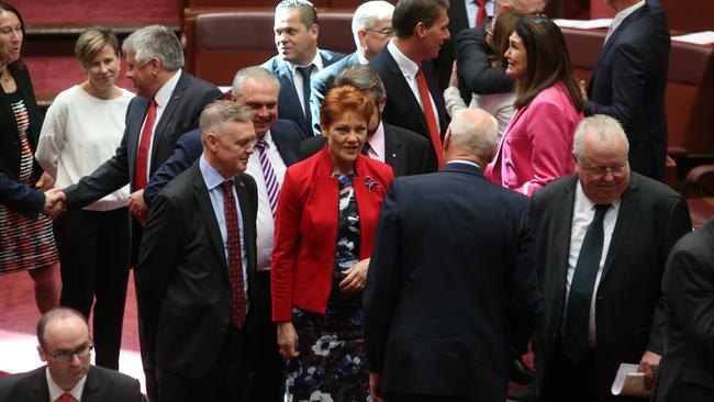 Senator Pauline Hanson congratulates Senator Jim Molan after being sworn in, in the Senate Chamber, Parliament House in Canberra.