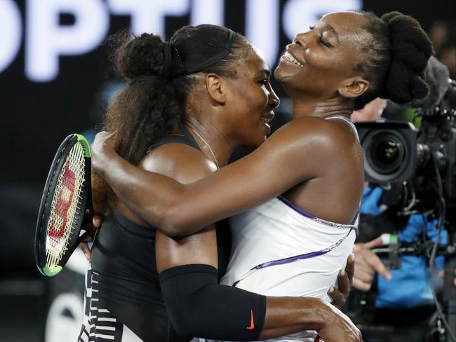 Serena and Venus embrace at the net after the match.