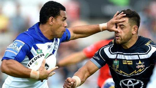 Will Hopoate of the Bulldogs palms off Justin O'Neill.