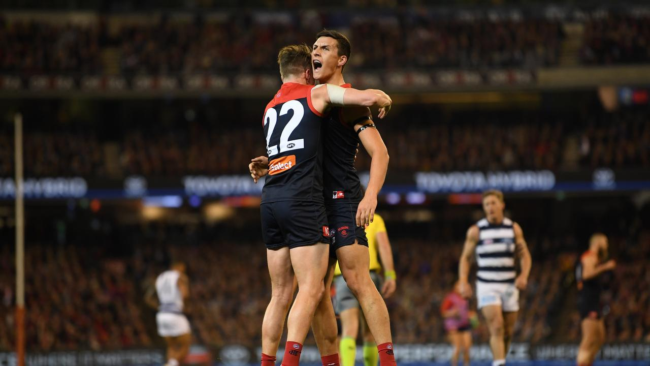 Aaron vandenBerg embraces Sam Weideman at the MCG on Friday night.