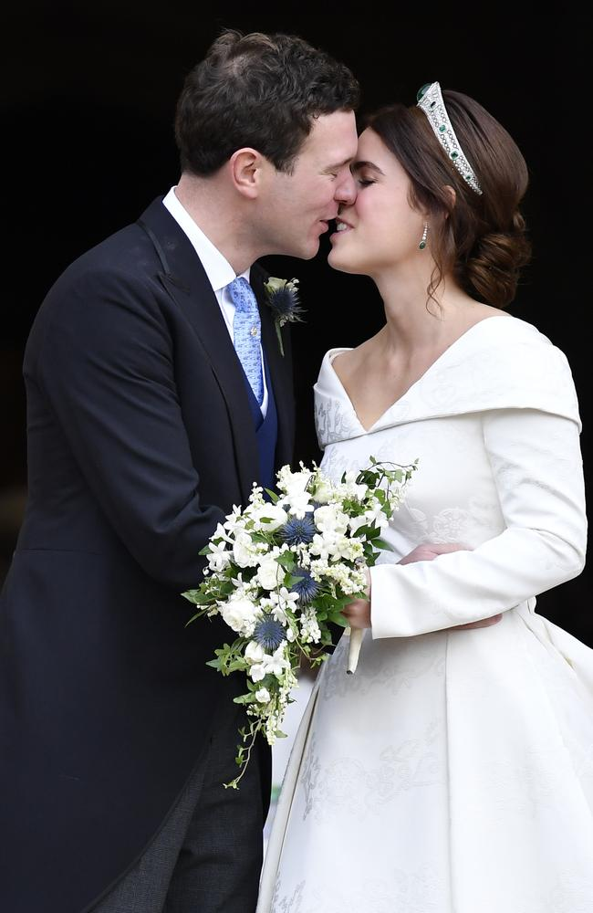 Princess Eugenie of York and her husband Jack Brooksbank kiss on the steps of St George's Chapel after their wedding. Picture: Getty