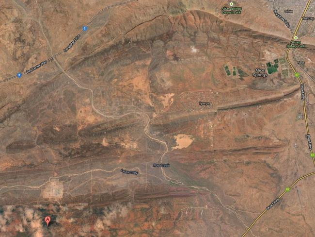 Pine Gap is the small cleared area above the pink A in the bottom left. The town of Alice Springs is top right. Picture: Google maps