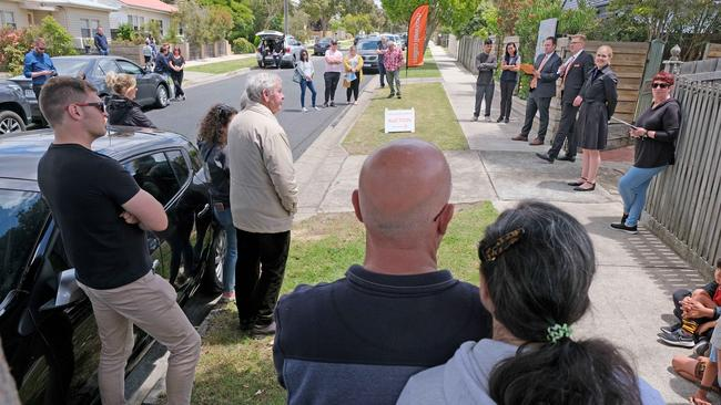 Three bidders emerged from the crowd. Picture: Mark Wilson