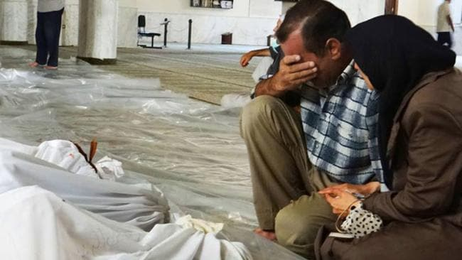 A couple mourn over the dead bodies of Syrian men. Picture: AP