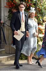 Rower Caspar Joplin, left, and singer Ellie Goulding depart after the wedding of Princess Eugenie of York and Jack Brooksbank at St George's Chapel, Windsor Castle, near London, England, Friday Oct. 12, 2018. (Matt Crossick, Pool via AP)