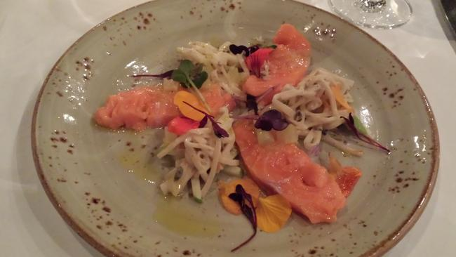 Confit New Zealand salmon with celeriac remoulade, citrus dressing and edible flowers.