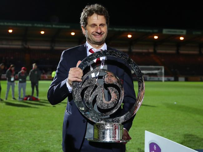 Joe Montemurro manager of Arsenal celebrates with the trophy.