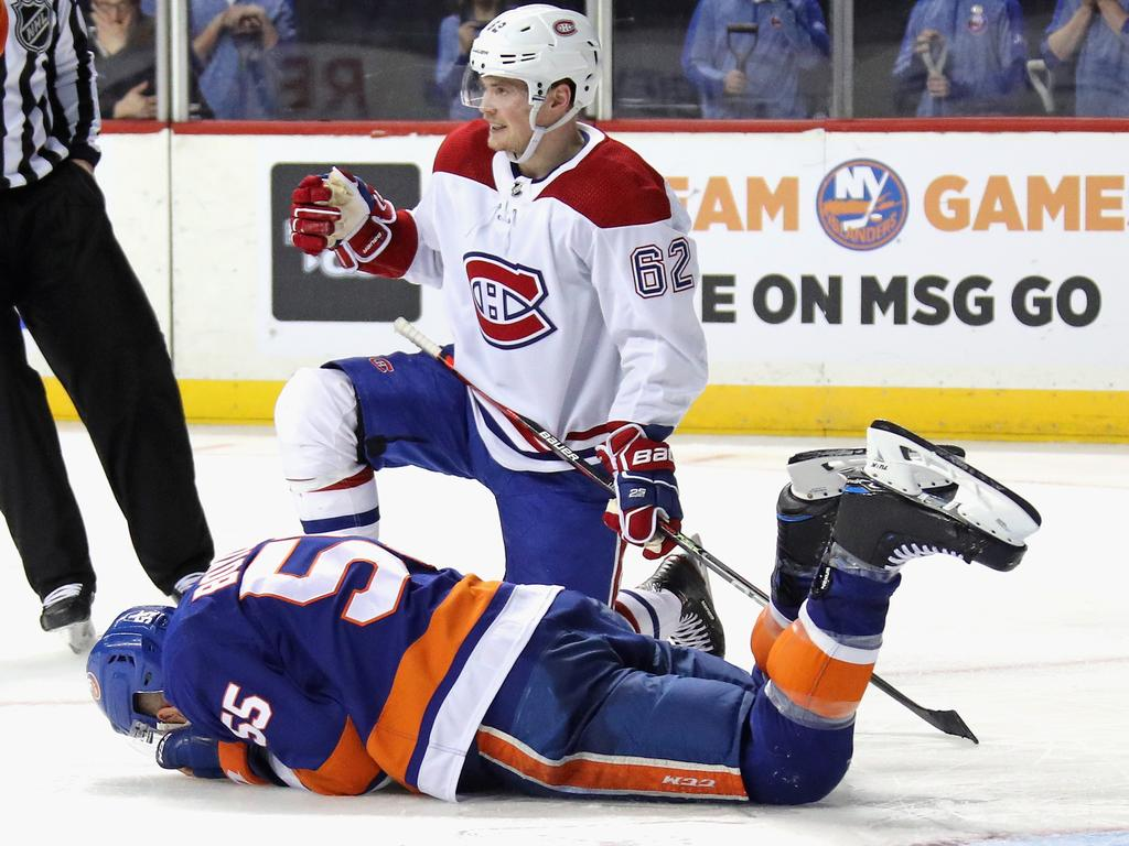 Johnny Boychuk lies prone on the ice after the incident.