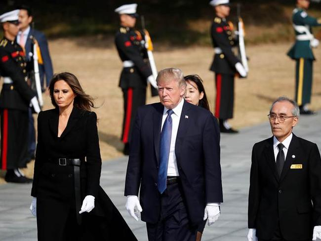 US President Donald Trump and First Lady Melania arrive to lay a wreath at the National Cemetery in Seoul. Picture: AFP