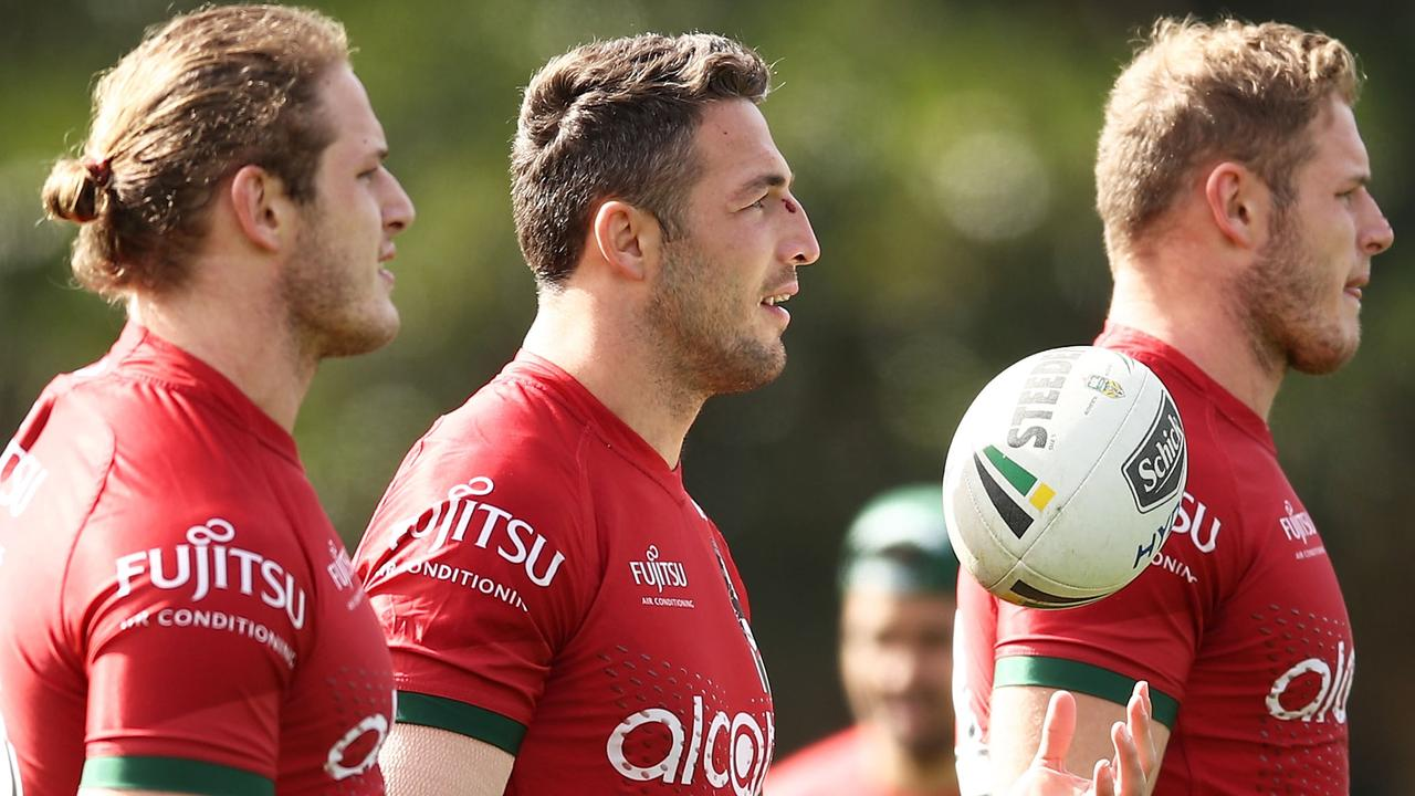 George Burgess, Sam Burgess and Tom Burgess look on during a South Sydney Rabbitohs training session at Redfern Oval.