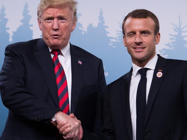 US President Donald Trump and French President Emmanuel Macron shake hands, while Macron also attempts a wink. Picture: AFP PHOTO / SAUL LOEB