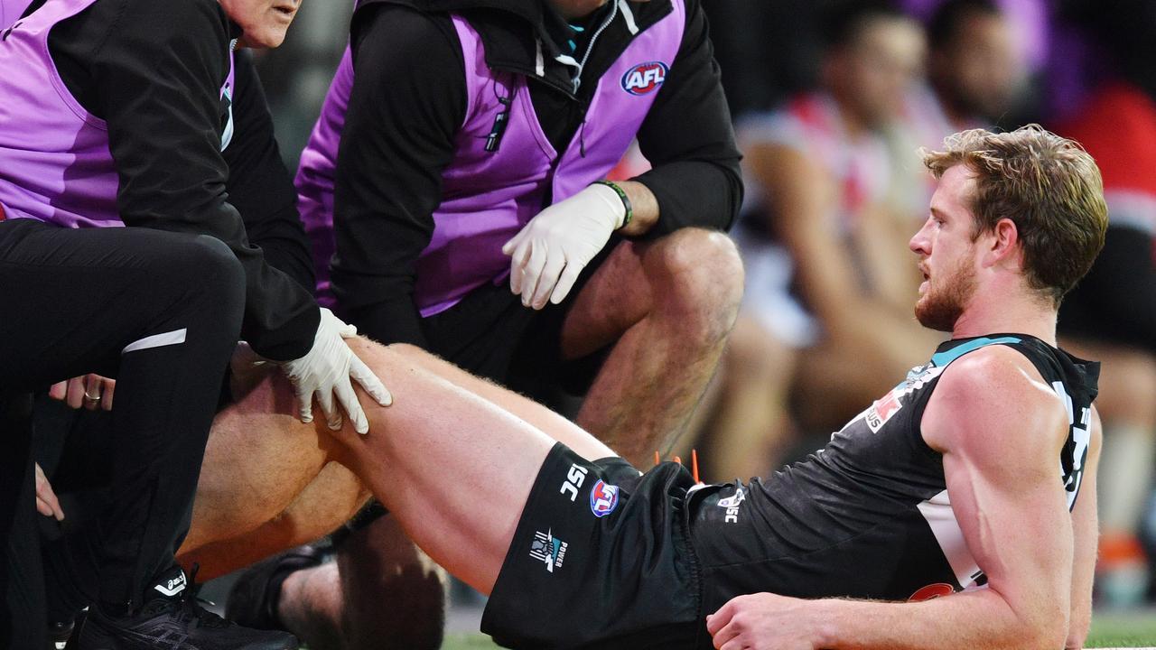 Tom Jonas has his knee checked by medical staff on Saturday night.