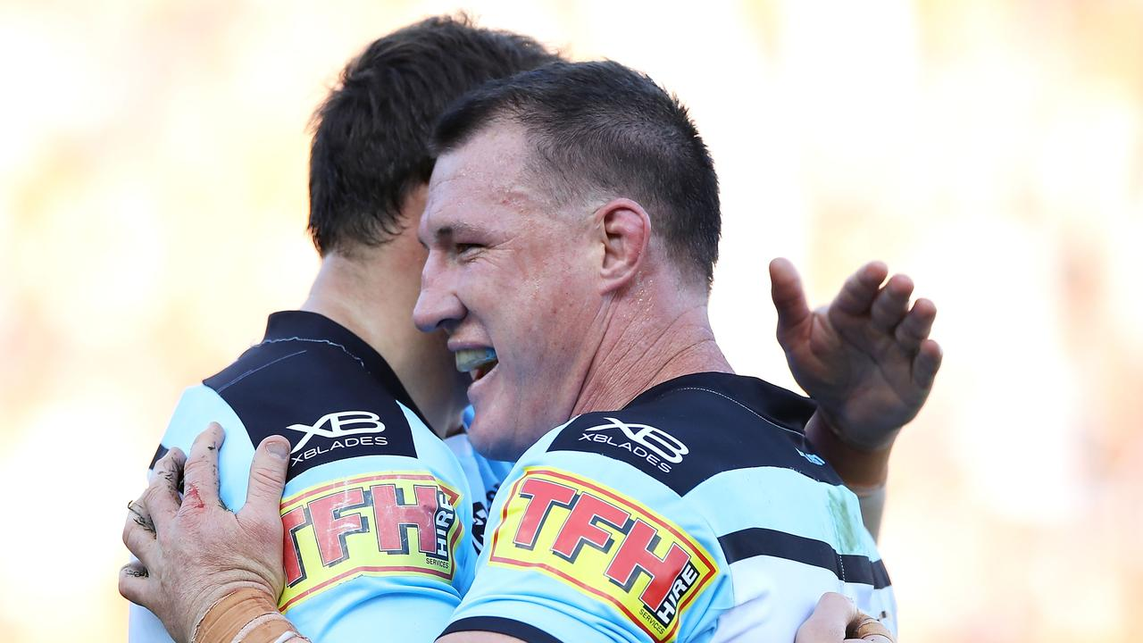 Josh Morris and Paul Gallen of the Sharks celebrate victory.