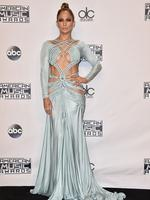 GO inside the 2015 American Music Awards. Featuring Jennifer Lopez, Rebel Wilson, Selena Gomez, Justin Beiber, The Weeknd plus many more: Jennifer Lopez poses in the press room at the American Music Awards in Los Angeles. Picture: AP