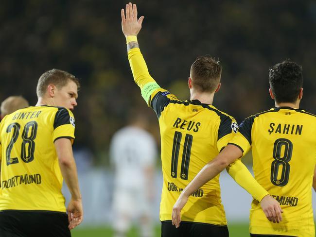 Dortmund's scorer Marco Reus (C) celebartes with (l-r) Matthias Ginter, Nuri Sahin.