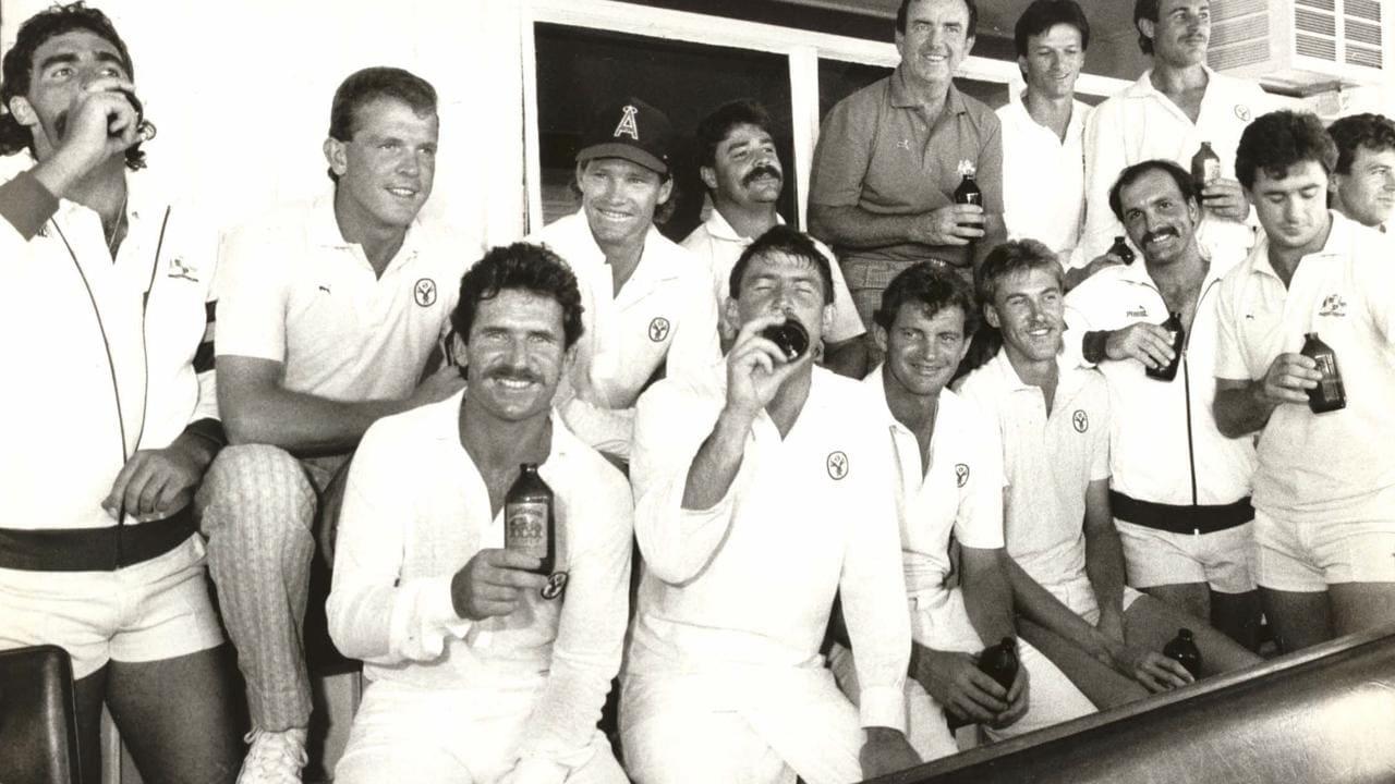 Australian cricket team drinking beer after a win.
