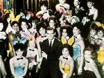 Playboy magazine founder and president Hugh Hefner with some of his bunnies at the Playboy Club, from the TV show 'America in The Fifties'.