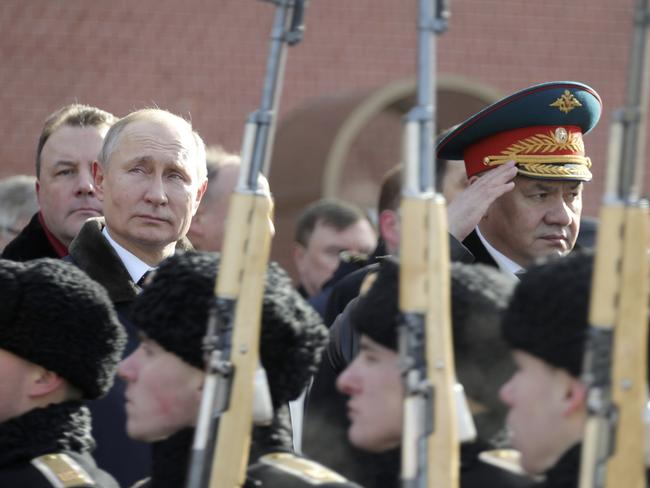 Russian President Vladimir Putin, left, and Defence Minister Sergei Shoigu, right, attend a wreath-laying ceremony at the Tomb of the Unknown Soldier in Moscow. Picture: Sputnik/AP