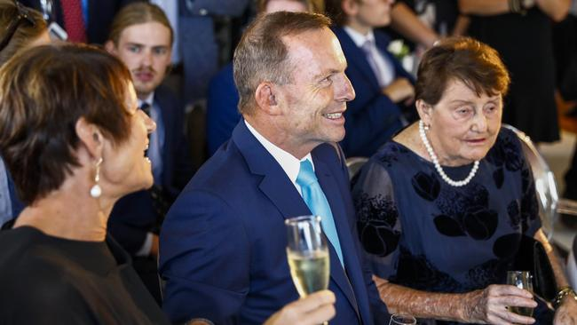 Margie Abbott (left) and Tony with mum Fay Abbott during the wedding ceremony. Picture: AAP Image/Supplied by @inlightenphotograhy