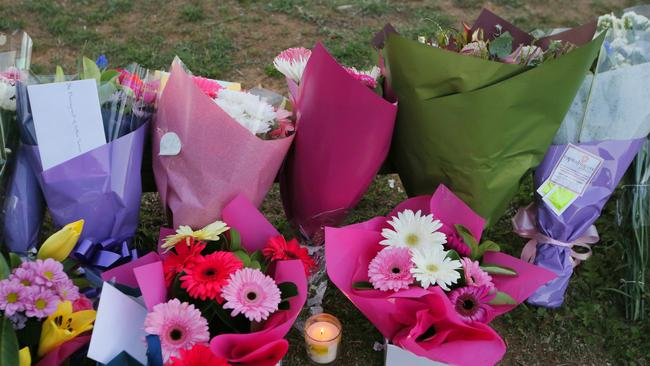 Flowers, candles and tributes were left outside the murder scene. Picture: Kym Smith