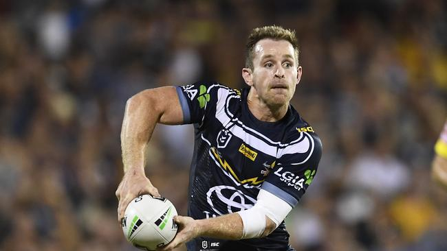 Michael Morgan of the Cowboys passes the ball during the NRL Trial match between the Melbourne Storm and the North Queensland Cowboys