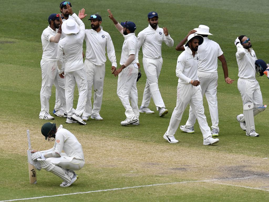 India players celebrate the win during day five of the first Test match between Australia and India at the Adelaide Oval in Adelaide, Monday, December 10, 2018. (AAP Image/Kelly Barnes) NO ARCHIVING, EDITORIAL USE ONLY, IMAGES TO BE USED FOR NEWS REPORTING PURPOSES ONLY, NO COMMERCIAL USE WHATSOEVER, NO USE IN BOOKS WITHOUT PRIOR WRITTEN CONSENT FROM AAP