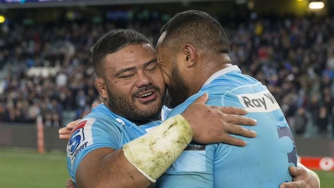Tolu Latu and Sekope Kepu of the Waratahs hug after the Super Rugby quarterfinal.