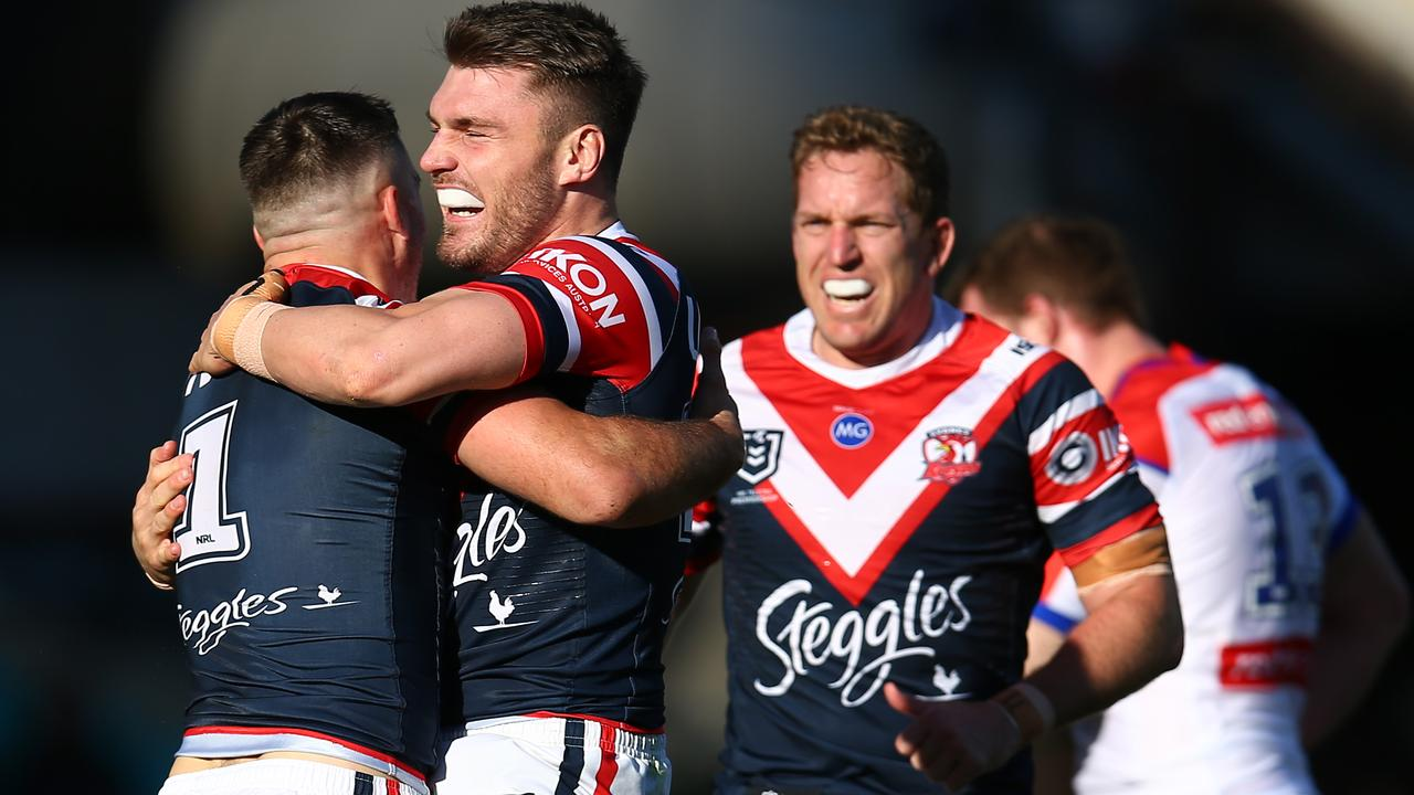 James Tedesco of the Roosters celebrates with Angus Crichton after scoring a try.