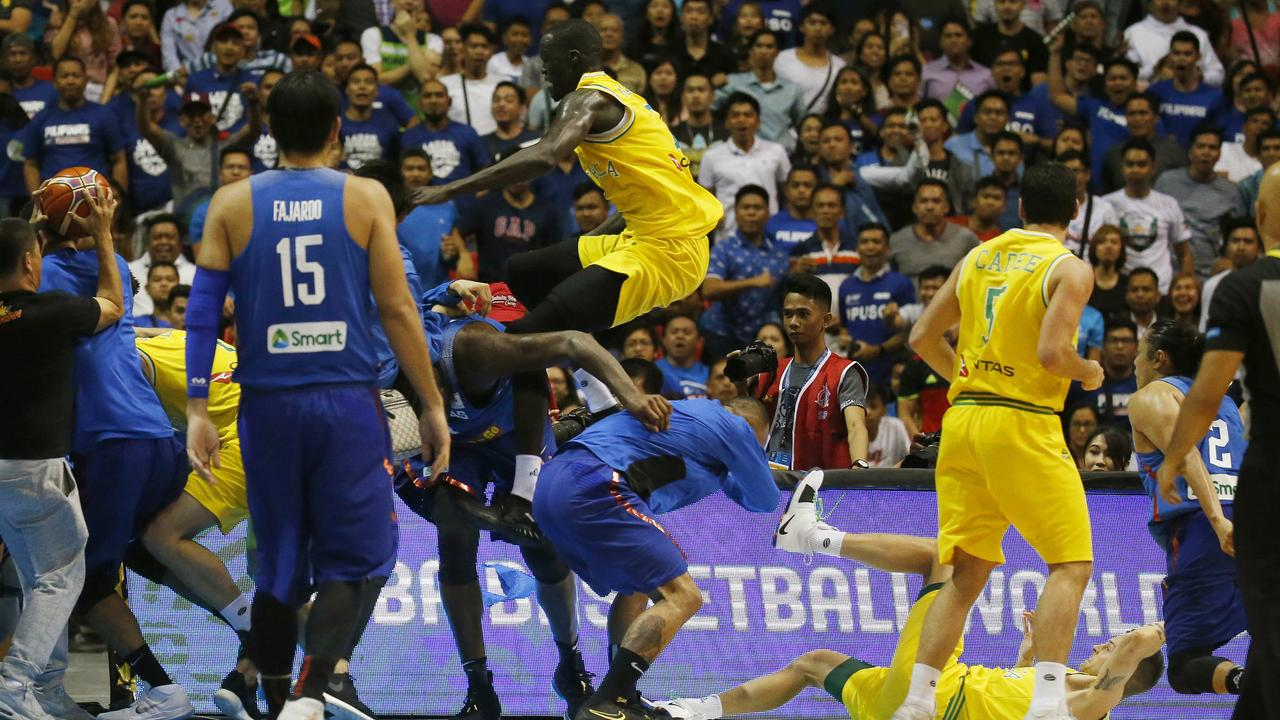 Thon Maker flies through the air with a kick as his Boomer's teammates are set upon during a wild brawl with the Philipines.