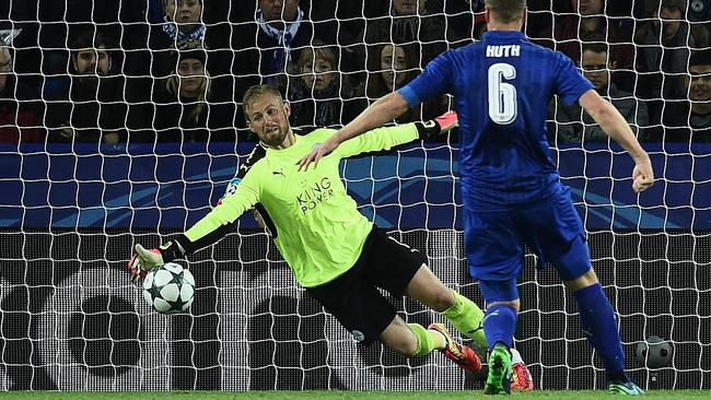 Leicester goalkeeper Kasper Schmeichel (L) makes a save against Copenhagen.