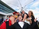 MELBOURNE, AUSTRALIA - NOVEMBER 01: Racegoers enjoy the atmosphere on Melbourne Cup Day at Flemington Racecourse on November 1, 2016 in Melbourne, Australia. (Photo by Michael Dodge/Getty Images)