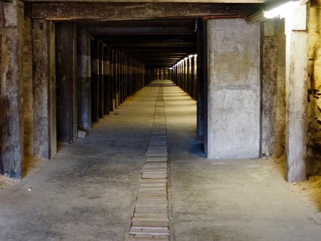 Dog Leg tunnel weaves its way through the belly of Cockatoo Island. Picture: Stephen van der Mark