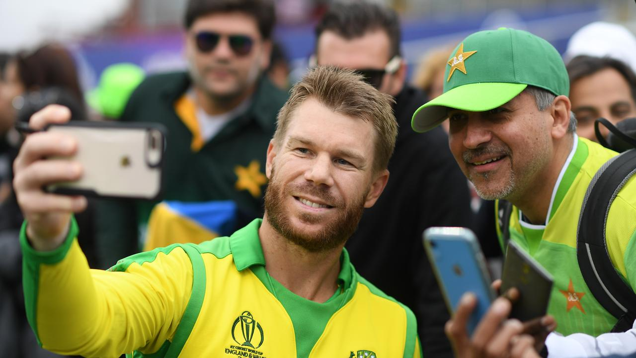 David Warner takes a photo with a fan. Photo: Alex Davidson/Getty Images.