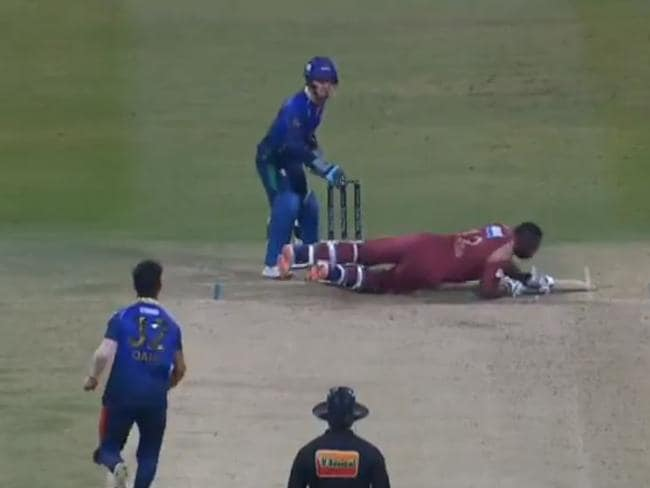Andre Russell dives for cover.