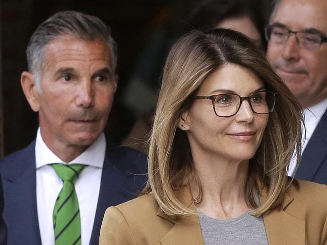 Lori Loughlin, front, and husband, clothing designer Mossimo Giannulli, left, depart federal court in Boston after facing charges last week. Picture: AP Photo/Steven Senne.