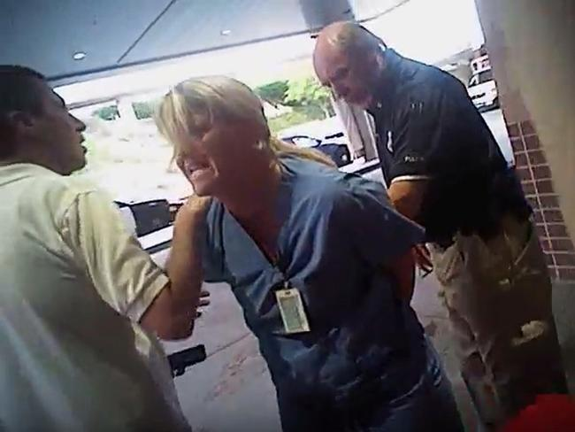 The Utah police department is making changes after an officer dragged a nurse out of a hospital in handcuffs when she told him he couldn't draw blood on an unconscious burns-unit patient. Picture: AP